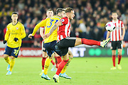 Sheffield United forward Billy Sharp (10) takes the ball down under pressure from Arsenal defender Sead Kolasinac (31)  during the Premier League match between Sheffield United and Arsenal at Bramall Lane, Sheffield, England on 21 October 2019.