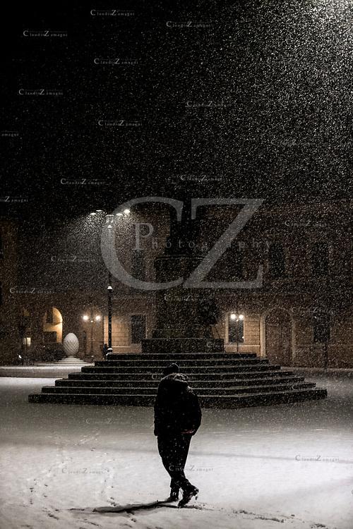Alone under snow on Ganganelli Square in Santarcangelo di Romagna Italy<br /> &copy;Claudio Zamagni