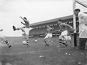 Armagh players defend their goal from attacking Kerry players during the All Ireland Senior Gaelic Football Final Armagh v Kerry in Croke Park on the 27th September 1953. Kerry 0-13, Armagh 1-06.
