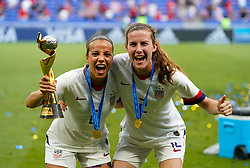 USA's Mallory Pugh (left) and USA's Tierna Davidson celebrate with the trophy after winning the FIFA Women's World Cup 2019