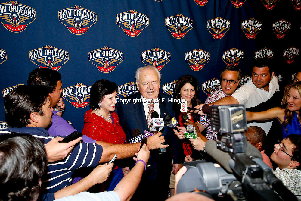 Aug 1, 2013; Metairie, LA, USA; New Orleans Pelicans owners Tom Benson and wife Gayle Benson with grand daughter Rita Benson LeBlanc address the media following a uniform unveiling at the team practice facility. Mandatory Credit: Derick E. Hingle-USA TODAY Sports