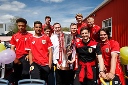 The U21 side pose with the JPT during the Bristol City open top bus parade to celebrate winning both the League 1 and Johnstone's Paint Trophy titles this season and promotion to the Championship - Photo mandatory by-line: Rogan Thomson/JMP - 07966 386802 - 04/05/2015 - SPORT - FOOTBALL - Bristol, England - Bristol City Bus Parade.