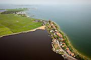 Nederland, Noord-Holland, Waterland, 28-04-2010; Uitdam aan de Uitdammerdijk, vroegere Waterlandse Zeedijk. Het dorpje is gelegen aan het Markermeer. Aan de horizon het eiland Marken..Uitdam at the Uitdammerdijk, former Waterlandse  Zeedijk. The hamlet is situated next to the Markermeer.luchtfoto (toeslag), aerial photo (additional fee required).foto/photo Siebe Swart