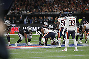 Derek Carr (QB) of the Oakland Raiders Eddie Jackson (DB) of the Chicago Bears during the International Series match between Chicago Bears and Oakland Raiders at Tottenham Hotspur Stadium, London, United Kingdom on 6 October 2019.