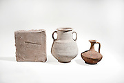 1st century Roman terracotta objects. From left to right Ceramic brick with inscription. Amphora and decanter