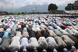 June 16, 2018 - Srinagar, Jammu and Kashmir, India - Thousands of Muslims offering Eid prayers at Dargah Srinagar. Eid is a festival Muslims celebrate the Eid Al-Fitr 1439 Hijri (Islamic Calendar) Day Ramadhan (Credit Image: © Arfath Naseer/Pacific Press via ZUMA Wire)