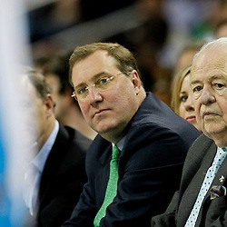 April 15, 2012; New Orleans, LA, USA; New Orleans Hornets newly named owner Tom Benson and  New Orleans Saints, Executive Vice President/Chief Financial Officer Dennis Lauscha watch courtside during the second quarter of a game against the Memphis Grizzlies at the New Orleans Arena.   Mandatory Credit: Derick E. Hingle-US PRESSWIRE