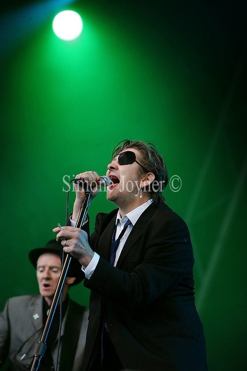 Shane McGowan of The Pogues performs live on stage during Madstock festival 2009 at Victoria Park on July 17, 2009 in London, England.  (Photo by Simone Joyner)