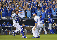 Kansas City Royals relief pitcher Wade Davis (17) and catcher Salvador Perez (left) celebrate to win the American League Championship after defeating the Toronto Blue Jays in game six of the ALCS at Kauffman Stadium.
