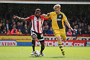 Brentford midfielder, Josh Clarke (36) battling for ball with Fulham defender, Tim Ream (13) during the Sky Bet Championship match between Brentford and Fulham at Griffin Park, London, England on 30 April 2016. Photo by Matthew Redman.