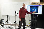 Dr. Peter Weyland explains the results of the test with running legend Ryan Hall at the SMU Locomotor Performance Lab in Dallas, Texas on March 18, 2016. (Cooper Neill for The New York Times)