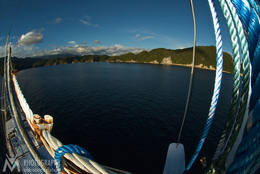 View from the lookout of a sailing boat around the Triton Bay coast line.