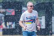 Henham Park, Suffolk, 20 July 2019. Superdry? The rain falls and people dash for cover - The 2019 Latitude Festival.
