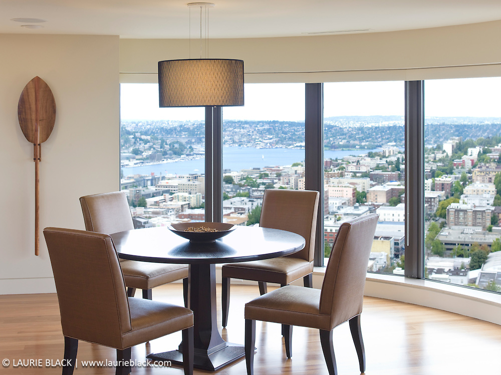 Contemporary condo dining room with a view