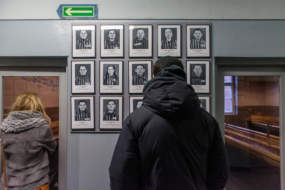 Visitors in the general exhibition at Block 7 in the Auschwitz Nazi concentration camp. On the left and right an original camp washroom. It is estimated that between 1.1 and 1.5 million Jews, Poles, Roma and others were killed in Auschwitz during the Holocaust in between 1940-1945.