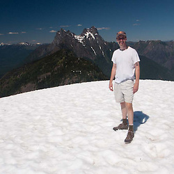 Joe on Desolation Peak Snowfield in front of Hozomeen, North Cascades National Park, Washington, US