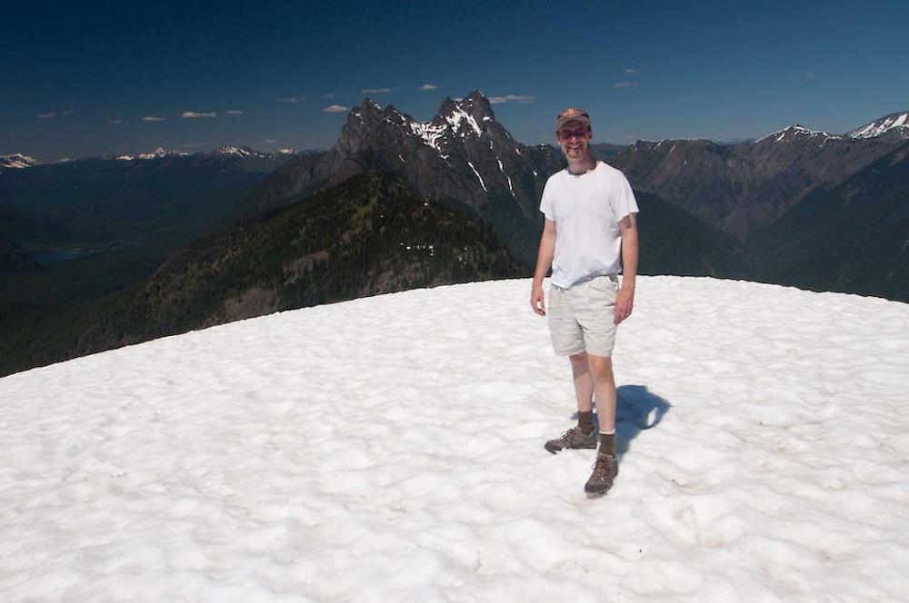 Joe on Desolation Peak Snowfield in front of Hozomeen, North Cascades National Park, Washington, US