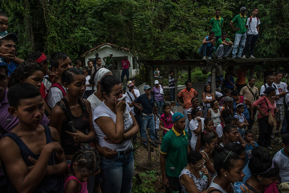 CAPAYA, VENEZUELA - NOVEMBER 29, 2016:  The town of Capaya held a funeral procession and group memorial for Eliecer Ram&iacute;rez, <br /> Anthony Vargas,<br /> Luis Alirio Sanz and<br /> Dennys Acevedo, all young men who were tortured and extrajudicially killed, without any sort of trial, by the Venezuelan army during an OLP operation, sanctioned by President Nicholas Maduro.  Families of the men and the small agricultural community claim the four men killed were innocent and not involved in any crimes. President Maduro ordered regular OLP operations to be held across the country to combat violent crime, however communities affected regularly claim only innocent people are being killed then falsely portrayed as criminals to justify their deaths.  PHOTO: Meridith Kohut for The New York Times