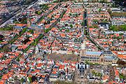 Nederland, Zuid-Holland, Delft, 09-05-2013; <br /> Historisch centrum van Delft zicht op de Markt met terrassen, de Nieuwe Kerk rechtsbeneden en het stadhuis er tegenover, Maria van Jessekerk haaks tegen de Nieuwe kerk(beneden). Linksboven de Oude Kerk, molen de Roos langs het spoor. Achter de Nieuwe kerk loopt het Oosteinde, de Oude Kerk bevindt zicht tussen de Oude Delft en Voorstraat. Tussen spoor en Oude Kerk bevindt zich museum het Prinsenhof.<br /> Historic center of Delft with terraces overlooking the Market, the New Church (r ) and Town Hall (l ).<br /> luchtfoto (toeslag op standard tarieven)<br /> aerial photo (additional fee required)<br /> copyright foto/photo Siebe Swart<br /> luchtfoto (toeslag op standard tarieven)<br /> aerial photo (additional fee required)<br /> copyright foto/photo Siebe Swart