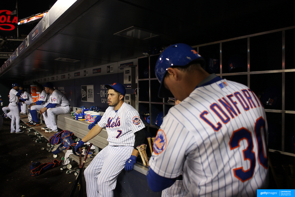 Travis d'Arnaud, (left) and Michael Conforto, New York Mets, preparing to bat in the dugout during the New York Mets Vs Atlanta Braves MLB regular season baseball game at Citi Field, Queens, New York. USA. 22nd September 2015. Photo Tim Clayton