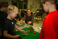Ray School teachers, parents and students came together Tuesday evening, November 27th, 2018 with direction from Pilot Light chefs to prepare and enjoy Middle Eastern salads as part of the Pilot Light program whose goal is to educate children about healthy food choices. <br /> <br /> 5137 - Parent, Chris Wurffel helps her son, Jonathan Ford and others make a Mediterranean salad.  <br /> <br /> Please 'Like' &quot;Spencer Bibbs Photography&quot; on Facebook.<br /> <br /> Please leave a review for Spencer Bibbs Photography on Yelp.<br /> <br /> Please check me out on Twitter under Spencer Bibbs Photography.<br /> <br /> All rights to this photo are owned by Spencer Bibbs of Spencer Bibbs Photography and may only be used in any way shape or form, whole or in part with written permission by the owner of the photo, Spencer Bibbs.<br /> <br /> For all of your photography needs, please contact Spencer Bibbs at 773-895-4744. I can also be reached in the following ways:<br /> <br /> Website &ndash; www.spbdigitalconcepts.photoshelter.com<br /> <br /> Text - Text &ldquo;Spencer Bibbs&rdquo; to 72727<br /> <br /> Email &ndash; spencerbibbsphotography@yahoo.com<br /> <br /> #SpencerBibbsPhotography <br /> #HydePark <br /> #Community <br /> #Neighborhood<br /> #CanonUSA