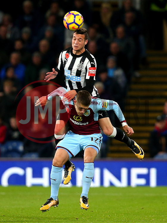 Javi Manquillo of Newcastle United beats Johann Gudmundsson of Burnley to a header - Mandatory by-line: Robbie Stephenson/JMP - 30/10/2017 - FOOTBALL - Turf Moor - Burnley, England - Burnley v Newcastle United - Premier League