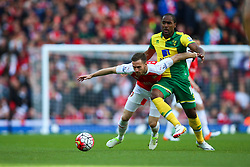 Aaron Ramsey of Arsenal is tackled by Cameron Jerome of Norwich City - Mandatory byline: Jason Brown/JMP - 07966386802 - 30/04/2016 - FOOTBALL - Emirates Stadium - London, England - Arsenal v Norwich City - Barclays Premier League