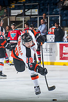 KELOWNA, CANADA - NOVEMBER 25: David Quenneville #19 of the Medicine Hat Tigers takes a shot during warm up against the Kelowna Rockets on November 25, 2017 at Prospera Place in Kelowna, British Columbia, Canada.  (Photo by Marissa Baecker/Shoot the Breeze)  *** Local Caption ***