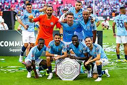 Riyad Mahrez, Benjamin Mendy and Bernardo Silva look on as Manchester City celebrate winning the Community Shield with a 2-0 victory over Chelsea - Rogan/JMP - 05/08/2018 - FOOTBALL - Wembley Stadium - London, England - Chelsea v Manchester City - The FA Community Shield.