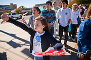23 JANUARY 2011 - PHOENIX, AZ:  A girl jeers a passing car while marchers with pro-life signs during the March for Life through Phoenix, AZ, Sunday. About 500 people participated in the pro-life march and rally, which marked the 38th anniversary of the US Supreme Court's Roe vs. Wade decision, which legalized abortion in the United States.    PHOTO BY JACK KURTZ