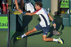 March 29, 2018 - Miami, FL, United States - KEY BISCAYNE, FL - MARCH, 29: Pablo Carreno Busta (ESP) slides under the net during day 11 action of the 2018 Miami Open held at the Crandon Park Tennis Center on March 29, 2018 in Key Biscayne, Florida.  Credit: Andrew Patron/Zuma Wire (Credit Image: © Andrew Patron via ZUMA Wire)