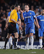 John Terry argues with Referee Wolfgang Stark (GER) during the second leg of the round of 16 UEFA Champions League match at home to Chelsea at Stamford Bridge football stadium, London on March 16, 2010.