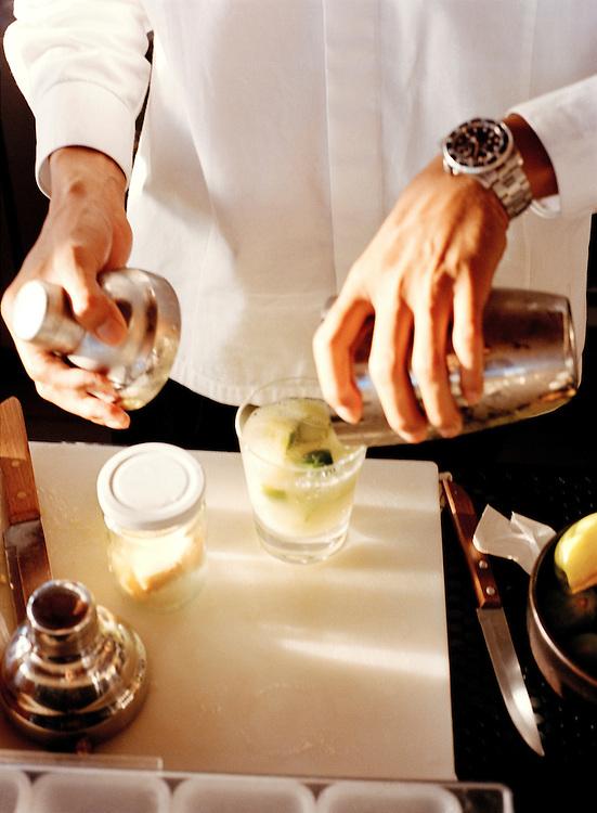 Bartender mixing drinks at the 5-star Trisara Resort