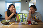 Sabrina Villanueva, left, eats breakfast with her friend Magdalena Granados at the University of Rochester in Rochester, New York on August 31, 2016. Villanueva earned 12 credits through a community college while in high school in Dallas, but the University didn't accept them, causing her to pursue a minor in Spanish rather than sociology or psychology as she had originally intended.