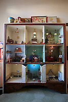 A doll's house displayed in a bedroom of Casa Mila in Barcelona, Spain