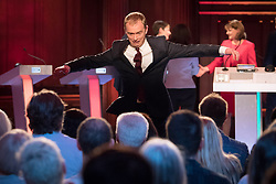 Liberal Democrats leader Tim Farron leaps off the stage after taking part in the BBC Election Debate hosted by BBC news presenter Mishal Husain at Senate House, Cambridge.