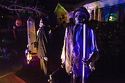 "A skeleton in Chris Baker's haunted yard in South Yarmouth, MA. Every year Baker sets up an elaborate Halloween display in his yard and on Halloween, neighborohood residents walk through his frightening ""vortex"" of horror while trick or treating."