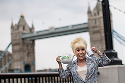 © licensed to London News Pictures. London, UK 07/05/2013. EastEnders star Barbara Windsor posing tea pot outside City Hall to promote the Big Lunch with Boris Johnson in London. Photo credit: Tolga Akmen/LNP
