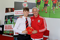 NEWPORT, WALES - Sunday, May 28, 2017: Joe Sullivan receives a cap from Elite Performance Director Ian Rush for participation during day three of the Football Association of Wales' National Coaches Conference 2017 at Dragon Park. (Pic by Mark Roberts/Propaganda)
