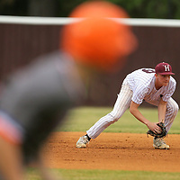 Houston second baseman Colton Peek keeps an eye on a runner as he looks to throw to home plate in the first inning against Nort Pontotoc.