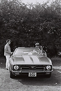 Patrick McGowan, Laul Clements looking at Ford Mustang Mk ll at West London car show, UK, 1984