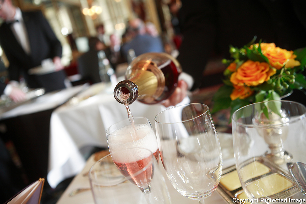 pouring pink champagne at theThe Michelin three star Restaurant Grand Vefour in Plais Royale,<br /> <br /> Paris