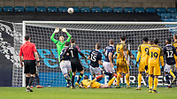 Football - 2018 / 2019 Emirates FA Cup - Sixth Round, Quarter Final : Millwall vs. Brighton<br /> <br /> Solly March (Brighton & Hove Albion) scores in the dying seconds as the ball drifts over David Martin (Millwall FC) at The Den.<br /> <br /> COLORSPORT/DANIEL BEARHAM