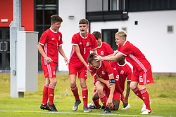 WREXHAM, WALES - Tuesday, August 13, 2019: Wales' captain Ben Lloyd celebrates scoring the first goal during the UEFA Under-15's Development Tournament match between Wales and Cyprus at Colliers Park with team mates (Pic by Paul Greenwood/Propaganda) Ethan Hartness, Daniel Watts, Rueben Evans