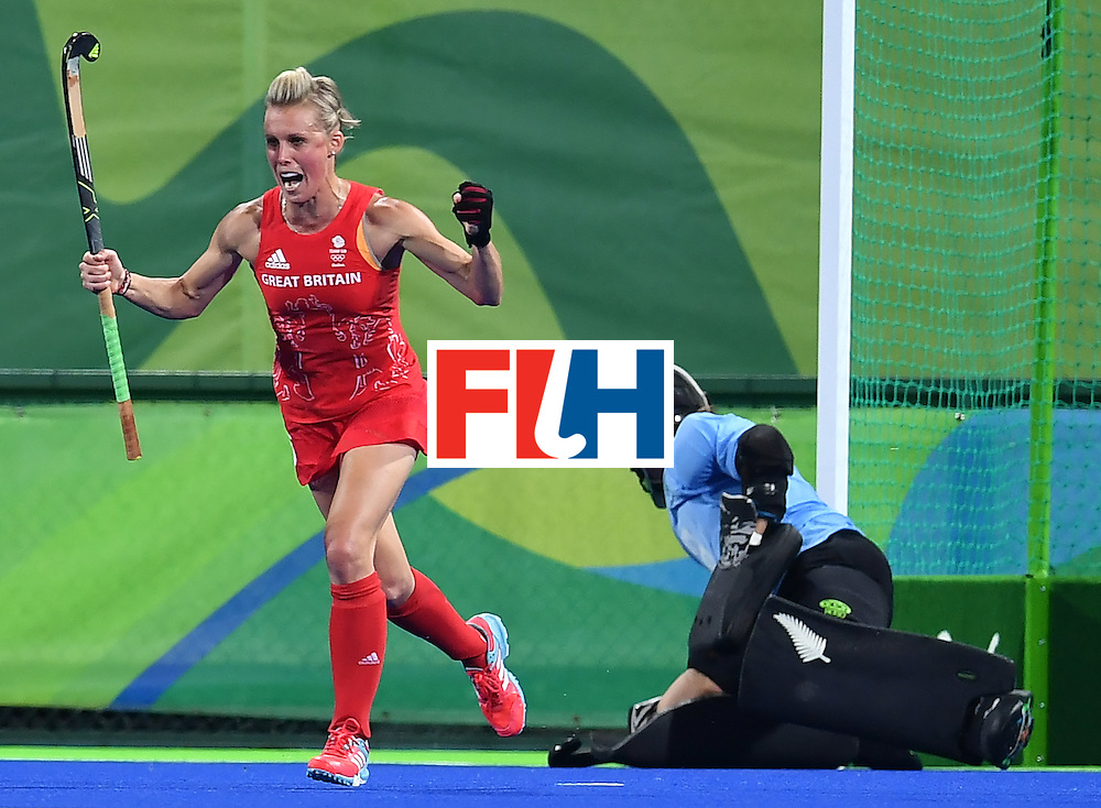 Britain's Alex Danson (L) scores a goal during the women's semifinal field hockey New Zealand vs Britain match of the Rio 2016 Olympics Games at the Olympic Hockey Centre in Rio de Janeiro on August 17, 2016. / AFP / MANAN VATSYAYANA        (Photo credit should read MANAN VATSYAYANA/AFP/Getty Images)