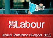 © Licensed to London News Pictures. 27/09/2011. LONDON, UK. A delegate reads a morning newspaper. The Labour Party Conference in Liverpool today (27/09/11). Photo credit:  Stephen Simpson/LNP