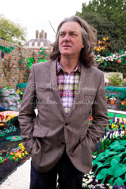 TV presenter James May being interviewed in his garden.<br /> Paradise in Plasticine. Design by James May, Chris Collins, Jane McAam Freud &amp; Julian Fullalove. Sponsor James May<br /> Plasticine Gold Medal Winner.
