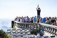 A man poses with an imitation World Cup trophy at the Cristo Redentor (Christ statue) at the top of the hill in Rio de Janeiro, Brazil. Photo by Andrew Tobin/Tobinators Ltd