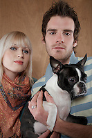Young couple with French Bulldog portrait