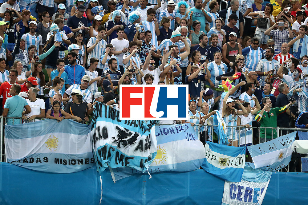 RIO DE JANEIRO, BRAZIL - AUGUST 18:  Argentina fans show their support during the Men's Hockey Gold Medal match between Belgium and Argentina on Day 13 of the Rio 2016 Olympic Games at Olympic Hockey Centre on August 18, 2016 in Rio de Janeiro, Brazil.  (Photo by Sean M. Haffey/Getty Images)
